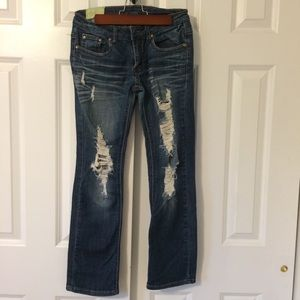 Boot cut denim jeans with rips